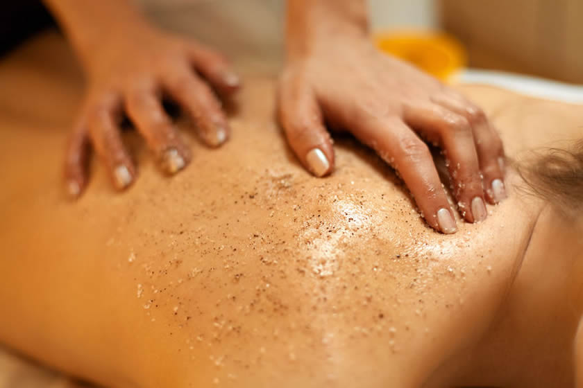 Massage therapy performed by professional therapist at Heed Spa